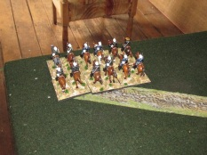 Meanwhile the Volunteer Cavalry blunder a command roll and retreat to their own table edge.