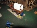 Buffalo Soldiers trying to stop their run-away wagon containing their gatling gun.